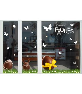 photo-vitrine-paques-boulangerie-patisserie-oeufs-lapin-chocolat-ruban-jaune-fleurs-papillons-herbes-etageres-suspensions-texte-joyeuses-paques-vitrophanie-electrostatique-sans-colle-repositionnable-DECO-VITRES